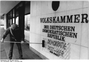 Slogan daubed on East German parliament - Democracy Here and Now!